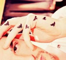 flying bird small tattoo on finger